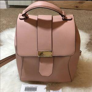 Blush pink back pack style purse